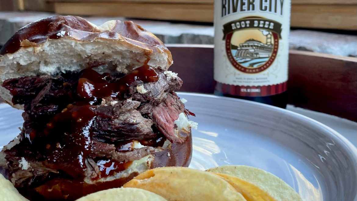 bbq beef sandwich with river city root beer homemade bbq sauce on plate